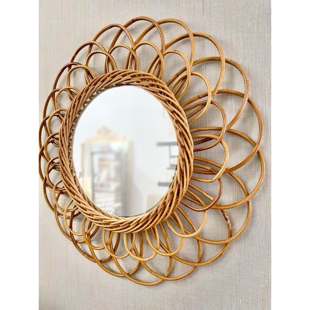 This fun vintage rattan mirror is from France, c. 1950's, and would add a touch of the eclectic to any interior
