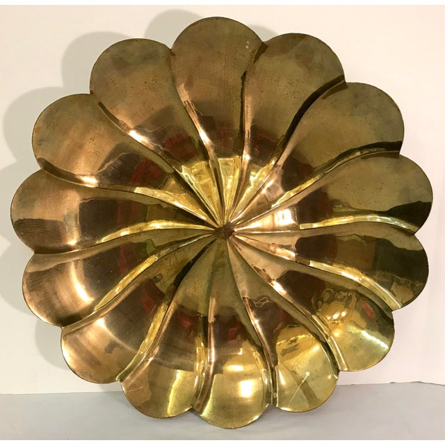 Lovely petal shaped brass bowl with hangar for hanging on wall. Made in the mid 20th century.