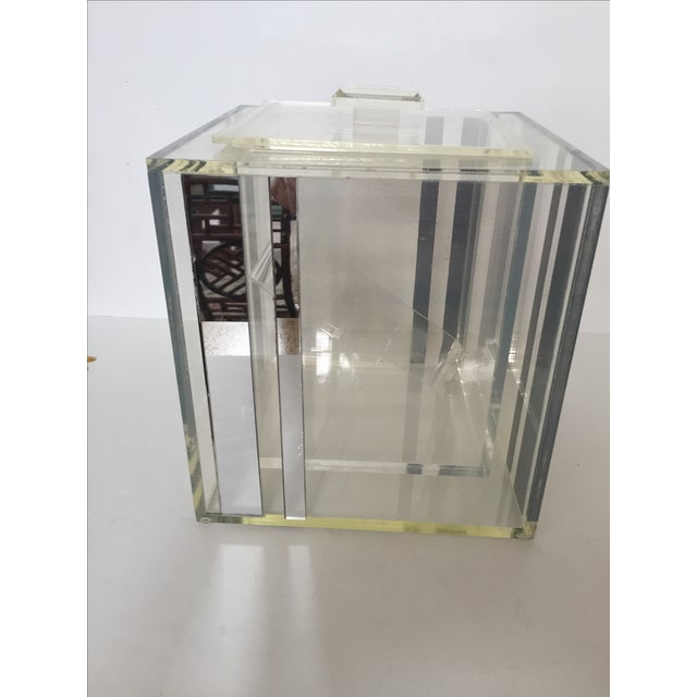 "This is an interesting ice bucket with mirrored accents. Each side has 2 mirrored strips, 1 is 1"" wide ,the other is 1/2""..."