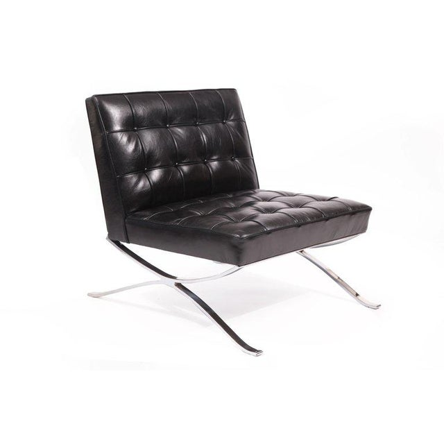 Rare pair of solid steel and leather lounge chairs by Hans Kaufeld, circa late 1950s. These examples have sculptural solid...