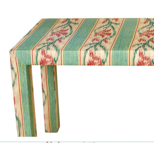 Custom Parsons style upholstered console in Southwest Ikat design.