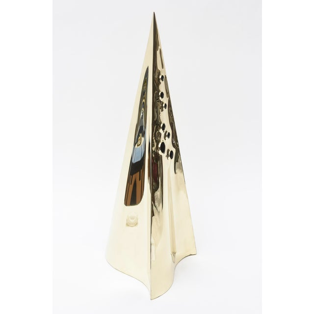 This fabulous vintage pyramid triangle brass tall sculpture has seven random purposeful holes that are different sizes...