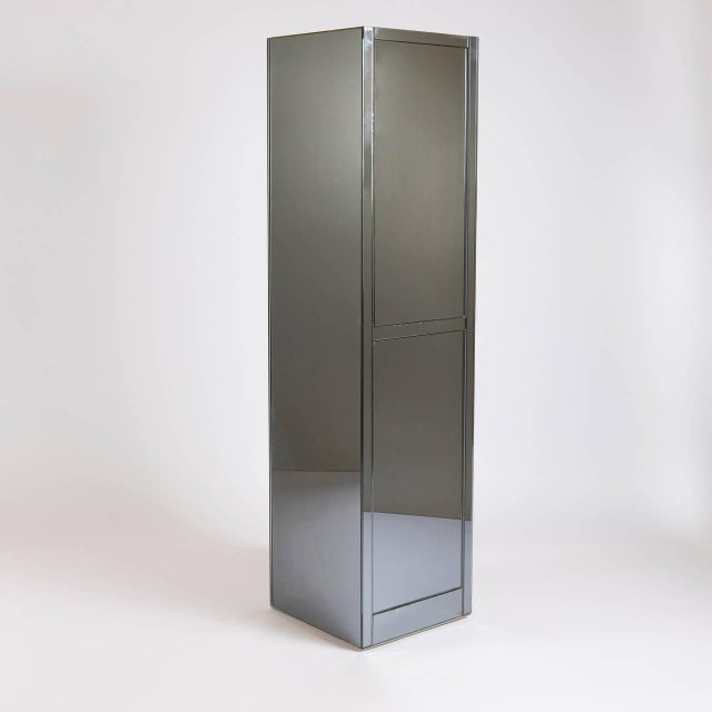 "Cabinet from ""Top"" collection by Nanda Vigo for FAI International. Fully mirrored piece features two push or pull doors..."
