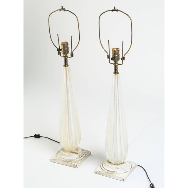Pair of 1960s gold fleck Murano lamps on wood bases.