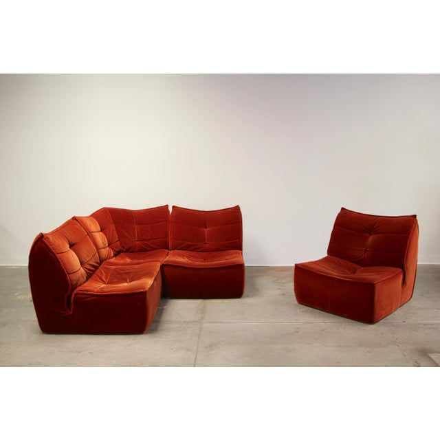 A wonderful 1970s French modular sofa in gorgeous ruby red Mohair upholstery. 4 individual modules allow you to create...