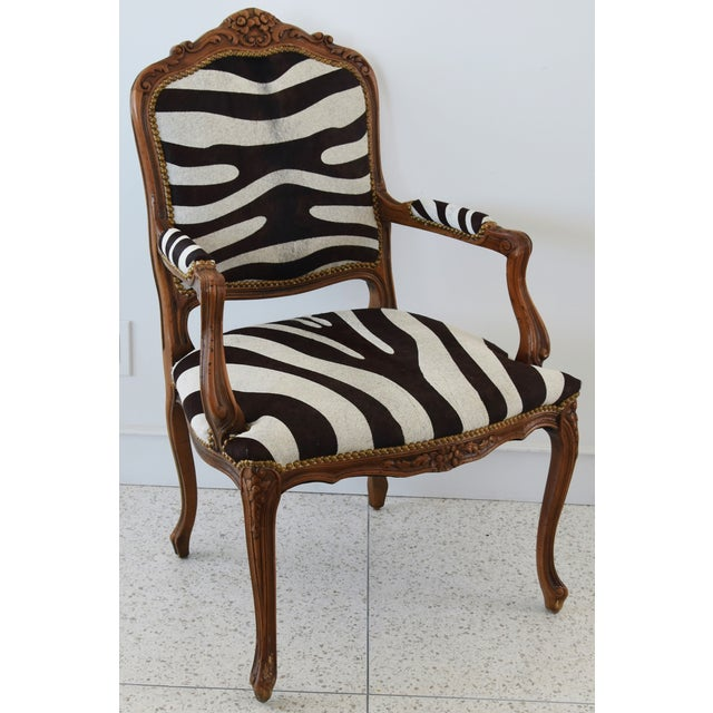 1950s carved walnut wood armchair newly upholstered in professionally stenciled and tanned zebra patterned striped hair-...