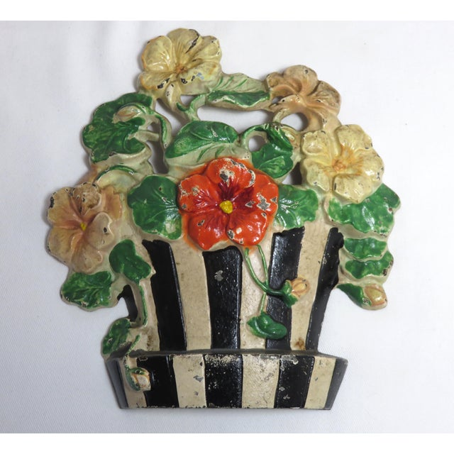 A vintage cast iron Nastrutiums flower doorstop with nice original hand-painted features. Made by the Hubley Foundry USA....