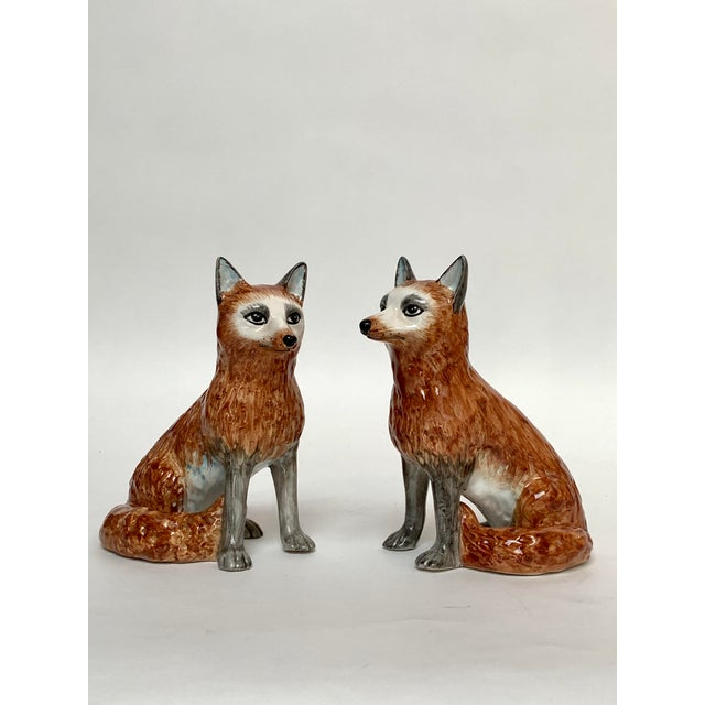 """Two similar ceramic fox figurines made in Italy ca. 1960s. The foxes measures about 8.5"""" high x 6"""" long x 4.5"""" wide,..."""