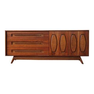 1960s Mid-Century Modern Restored Walnut Triple Dresser With Sliding Doors For Sale