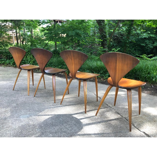 Set of 4 Plycraft pretzel chairs designed by Norman Cherner. These are in phenomenal condition for their age. The chairs...