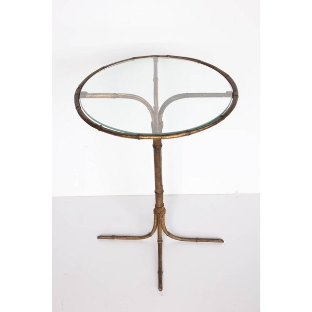 Stylish Italian gold leaf base martini table with glass top.