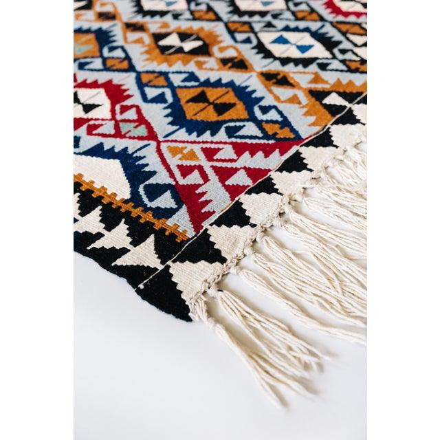A Turkish Kilim Rug. Origin: Eastern Turkey Material: Wool over wool Main Motif: Ramhorn and Evil Eye Protector Care: No...