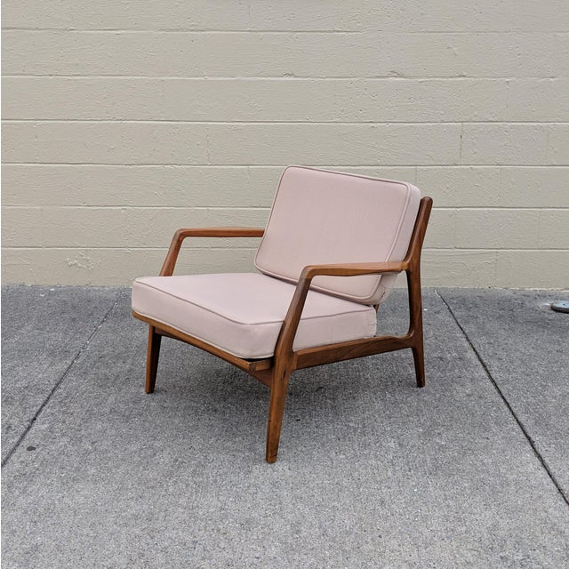 This sleek lounge chair designed by Ib Kofod-Larsen for Selig in Denmark, circa 1960s is in great vintage condition! This...