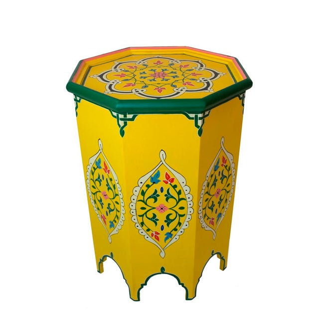 This side table is handmade and hand-painted in Morocco by our artisan group. It serves as an excellent piece of decor...