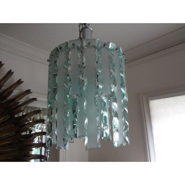 Chic Italian Zero Quattro-Fontana Arte mid-century modern sandblasted glass lantern, pendant or chandelier with a chrome...