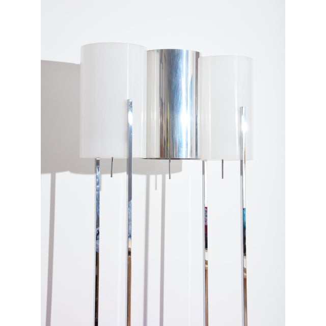 Vintage circa 1970s chrome floor lamp with shelves. Unique and elegant design perfect for a living room. Three shades with...