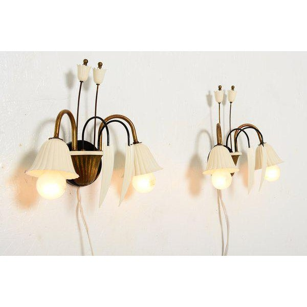 For your consideration a pair of Italian wall sconces. Beautiful with a flower shape. Aluminum shades in off white color....