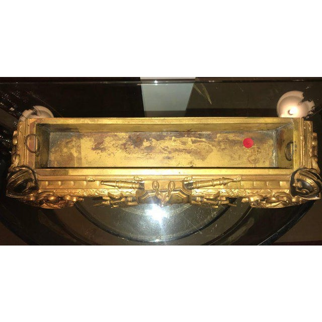 An Empire 19th century dore bronze Jardinière with insert. This small rectangular planter is cast wonderfully with no...