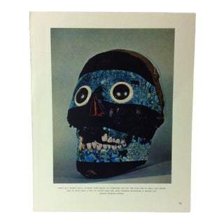 """Circa 1960 """"Front of a Human Skull Adorned With Mosaic of Turquoise and Jet"""" Treasures of Ancient America Mounted Print For Sale"""