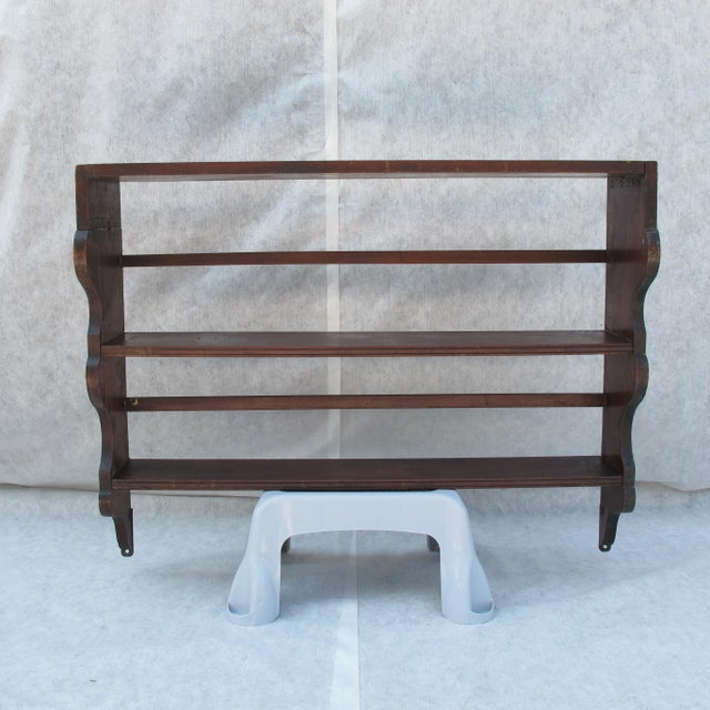 This vintage ship's shelf retains it original finish. The shelf was originally folding and it was later changed to be...