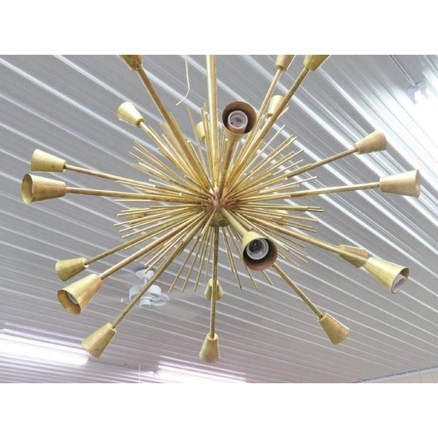 Modern design brass Sputnik chandelier with spikes and arms.