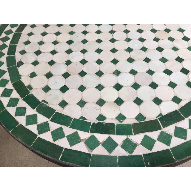 Moroccan mosaic tile bistro table on iron base. Handmade by expert artisans in Fez, Morocco using reclaimed old glazed...