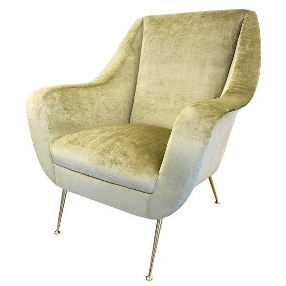 Pair of Italian Mid-Century lounge chairs with soft sloping lines and brass feet. One has been upholstered in a light...