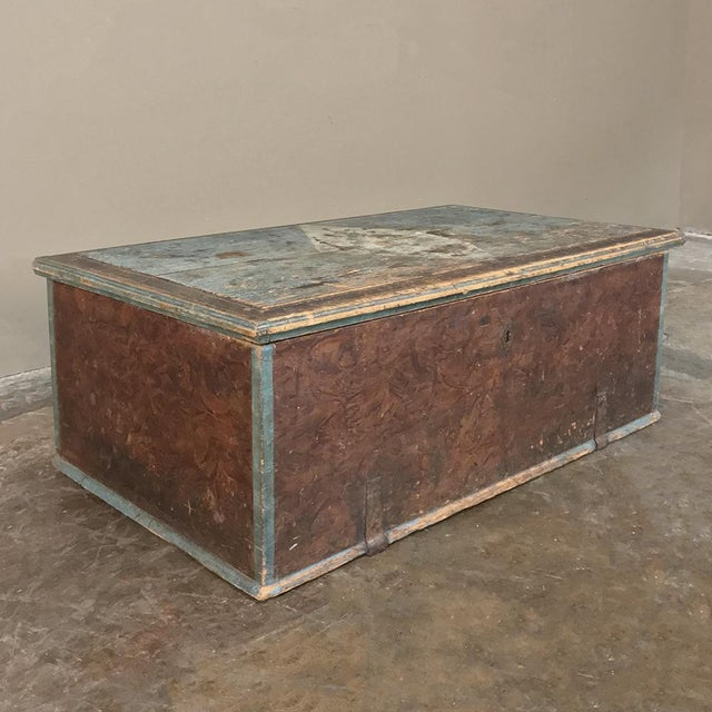 19th Century Rustic Swedish Painted Trunk will add a charming European touch to your decor, with varied pastel coloration...