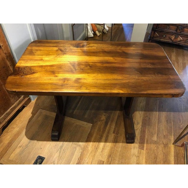 Small 19th century French provincial Circassian walnut table with trestle base. Made of highly figured Circassian walnut...