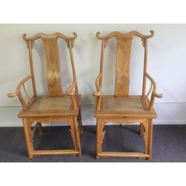 Great looking pair of antique Chinese Arm Chairs with woven Natural material seat . These are very old and the...