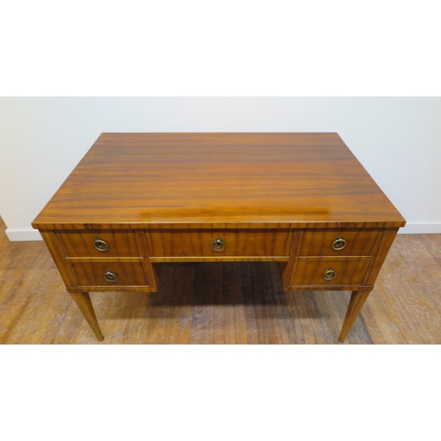 Midcentury tiger wood desk. Italian midcentury desk of tiger wood having five drawers solid brass hardware. The desk has a...