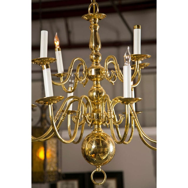 Georgian Style Chandelier. The central support comprised of a group of four circular balls with a set of twelve sprawling...