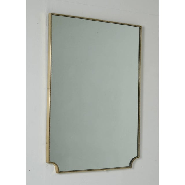 Simple and elegant 1950s brass frame mirror with a beautiful mild patina in the brass. Mirror can also be hung the other...
