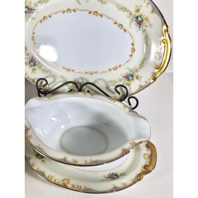 Replacements calls pattern EM24. This set includes: 1- gravy bowl with attached plate 1- small bowl 1- lid 1- serving...