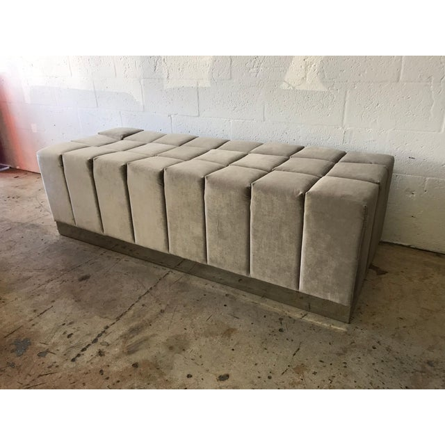 Biscuit tufted bench or ottoman stool rendered in grey, gray velvet and mirror polished stainless steel in the style of...