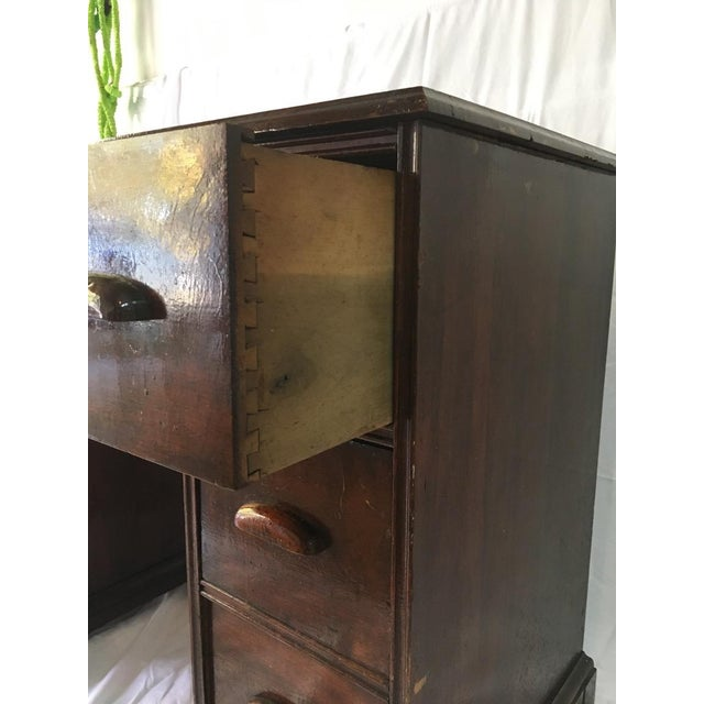 This vintage wood desk will create a beautiful an elegant presence to any room. The drawers are dovetailed and piece is in...