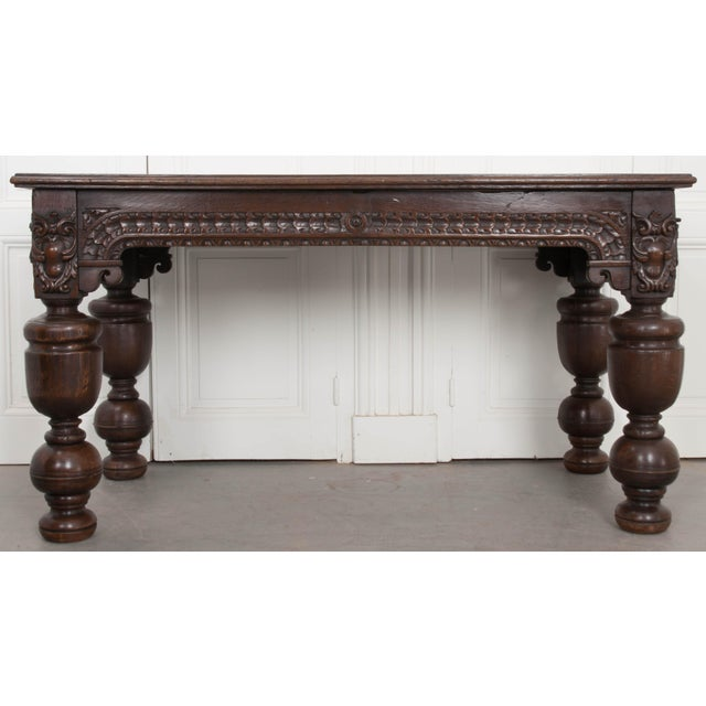 This substantial oak table was carved by hand in France, circa 1750. The table's apron features exceptionally detailed and...