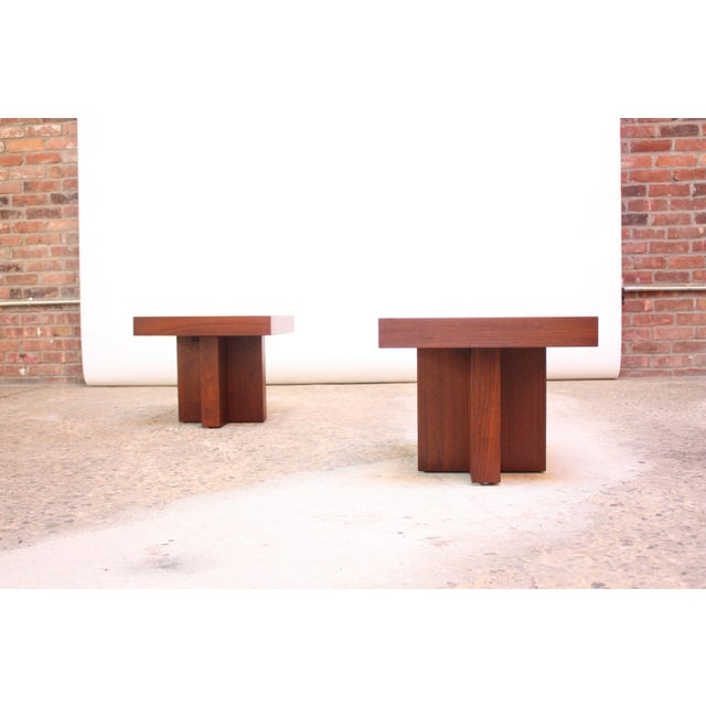 End / occasional tables designed by Milo Baughman (circa 1970) composed of walnut-veneer wrapped rectangular tops on...