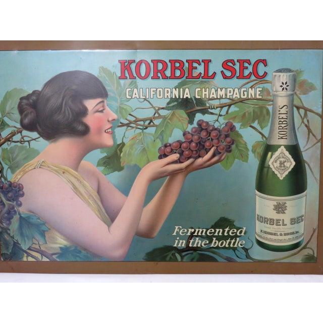 A beautiful original Tin Lithograph Korbel Sec California Champagne Advertising Sign. Circa early 1900s. It has wonderful...