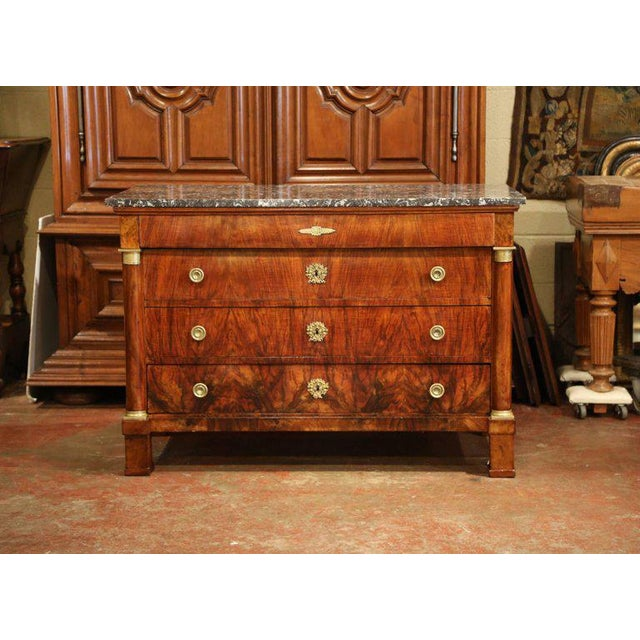 This elegant, antique fruitwood chest of drawers was crafted in France, circa 1830. The traditional commode with veneer...