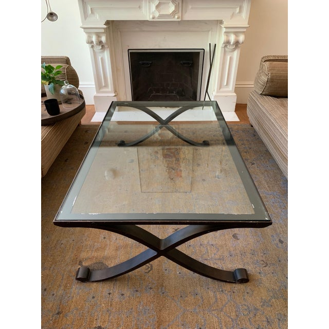 This Carole Cocktail table, in a patinated bronze with a glass top, is a great addition to a living room. Well loved and...