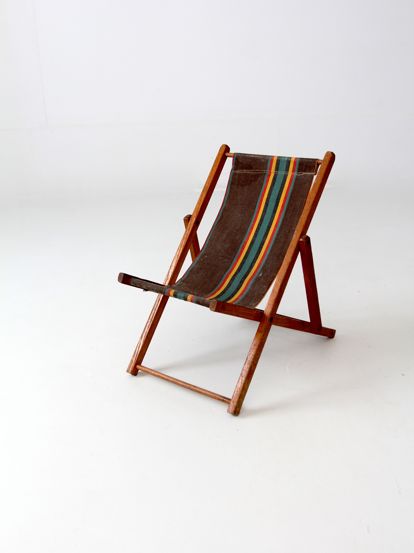 A Vintage 1950s Childrenu0027s Deck Chair. The Classic Wood Frame Folding Chair  Features A Striped