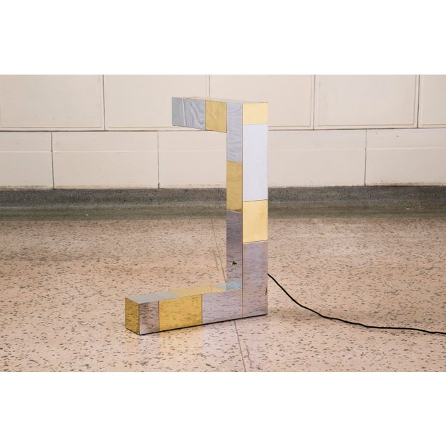 Cityscape by Paul Evans Studio for Directional brass and chrome cantilever desk lamp.
