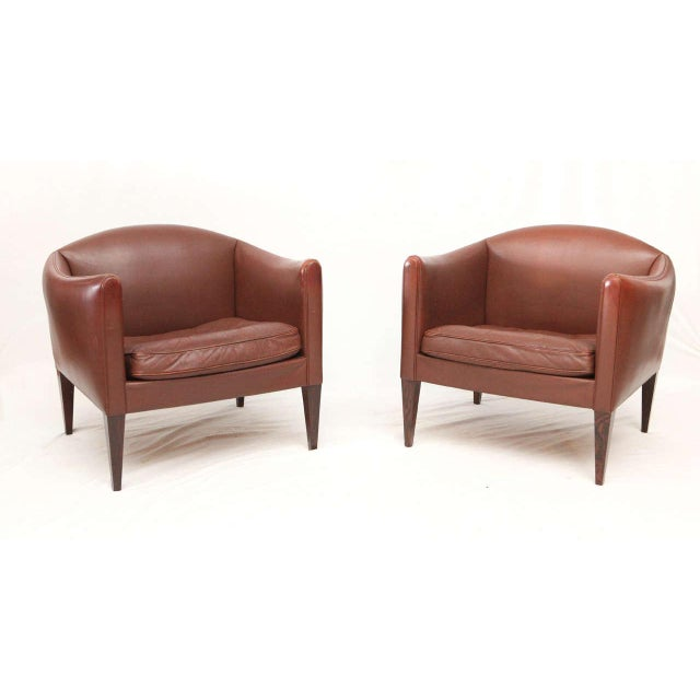 Pair of Illum Wikkelso Leather Lounge Chairs With Rosewood Legs. Nice Original Brown Leather. Store formerly known as...