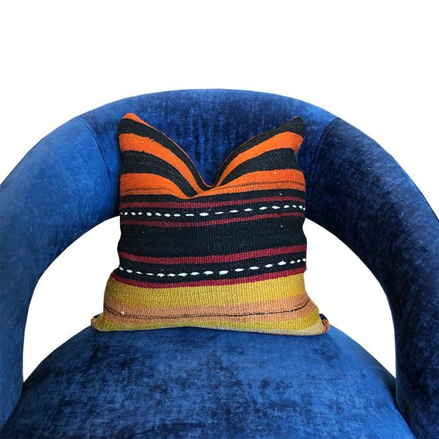 """Square 15"""" x 15"""" turkish rug pillow with down fill. Features folk tribal stripe print on front and blue solid back. Zipper..."""