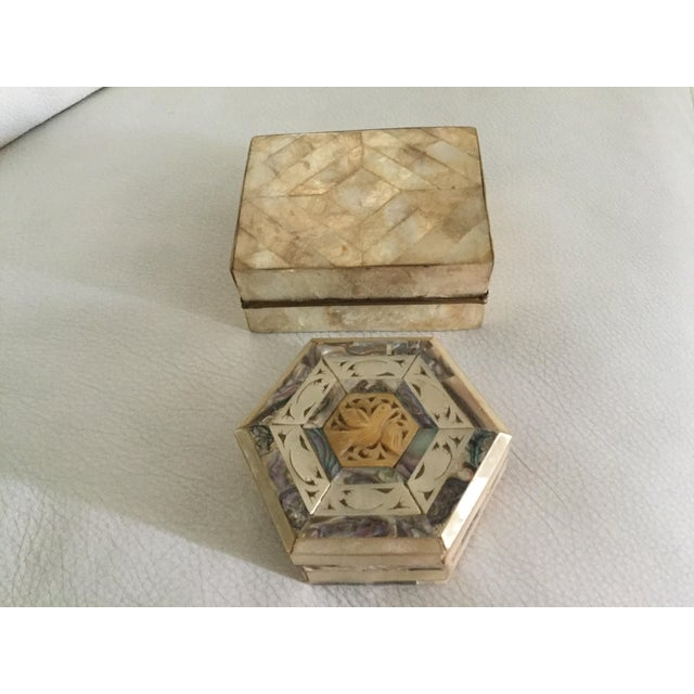 Exquisite antique pair of Mother-of-Pearl inlaid and carved decorative boxes. Good condition, some inlaid pieces are...