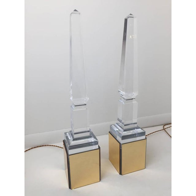 Truly unique all acrylic obelisk monuments on a lucite light stand which lights from underneath. Provides great ambient...