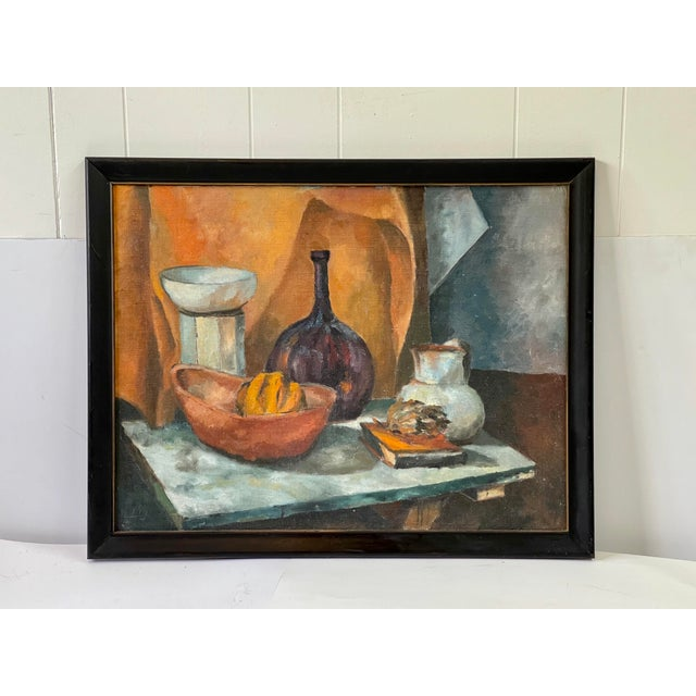Midcentury still life oil painting of a tabletop. Among the vases, there is a bowl holding a squash and an artichoke...