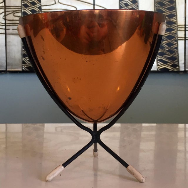 Mid-century modern Dutch copper bullet planter on tripod stand. Signed inside. Wear consistent with age and detailed in...