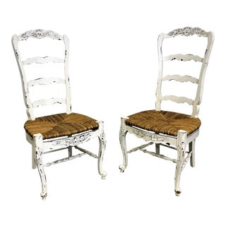 Pair of French Country White Carved 4-Rung Rush Seat Ladderback Dining Chairs For Sale